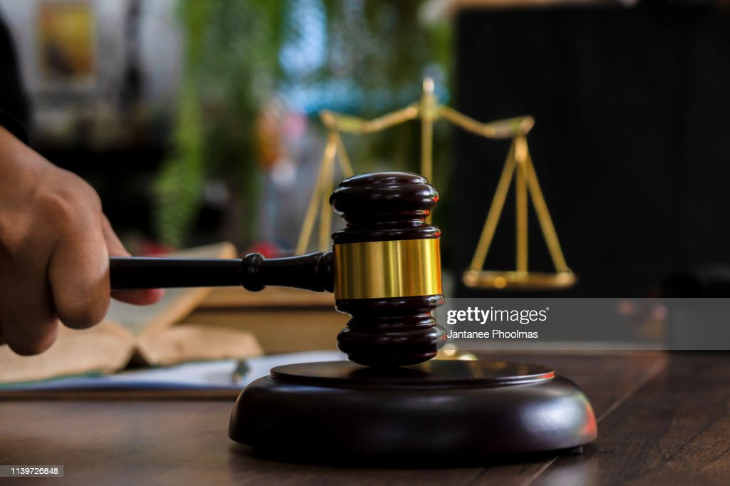 Law and justice concept. Judge's gavel, scales, hourglass, books. : Stock Photo