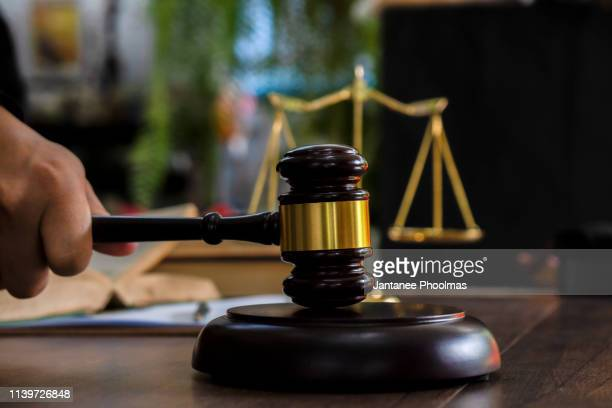 law and justice concept. judge's gavel, scales, hourglass, books. - justice photos et images de collection