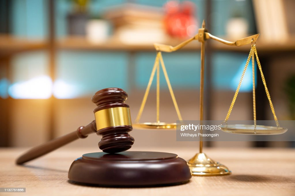 Law and justice concept. Judge's gavel, scales, hourglass, vintage clock, books : Stock Photo
