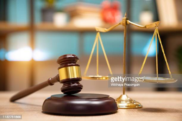 law and justice concept. judge's gavel, scales, hourglass, vintage clock, books - justice photos et images de collection