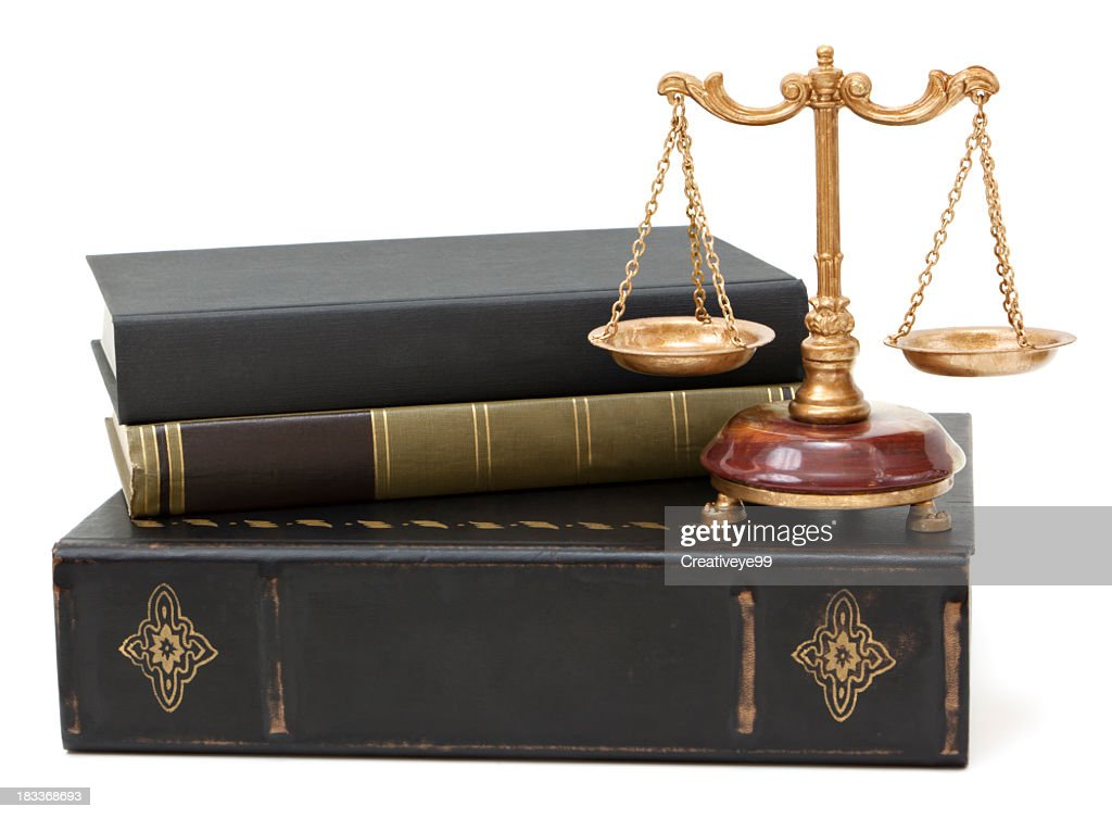 Law books and scales of justice : Stock Photo