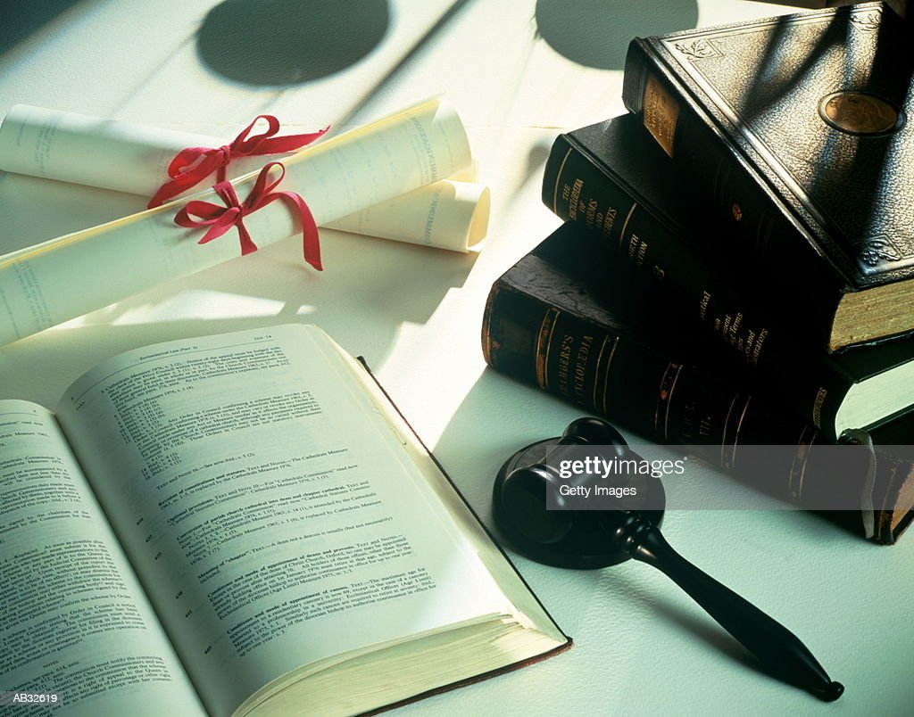 Law books, gavel and scrolls on table, close-up : Stock Photo