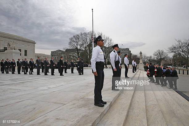 Law clerks past and present line the steps as the casket of Associate Justice Antonin Scalia is carried by US Supreme Court police officers up the...