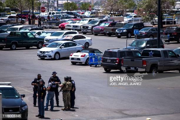 Law enforcement agencies respond to a shooting at a WalMart near Cielo Vista Mall in El Paso Texas Saturday Aug 3 2019 A shooting at a Walmart store...