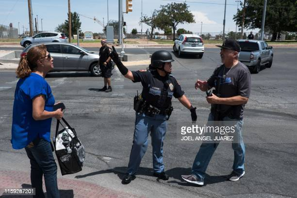 Law enforcement agencies respond to an active shooter at a WalMart near Cielo Vista Mall in El Paso Texas Saturday Aug 3 2019 Police said there may...