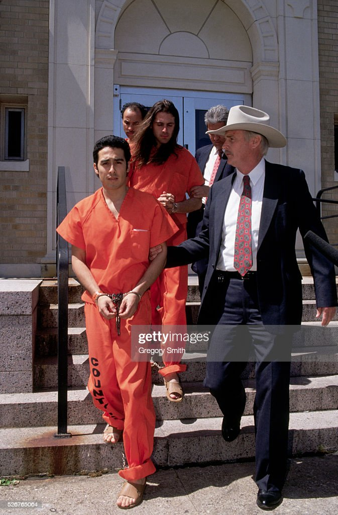 Law enforcement agents escort members of the Branch Davidians from federal court in Waco, Texas. Surviving members of the 1993 ATF raid on the Davidians' Mount Carmel complex were brought to trial for their role in the deadly standoff.