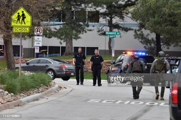 Law enforcement agents patrol the scene of a shooting in which at least seven students were injured at the STEM School Highlands Ranch on May 7 2019...