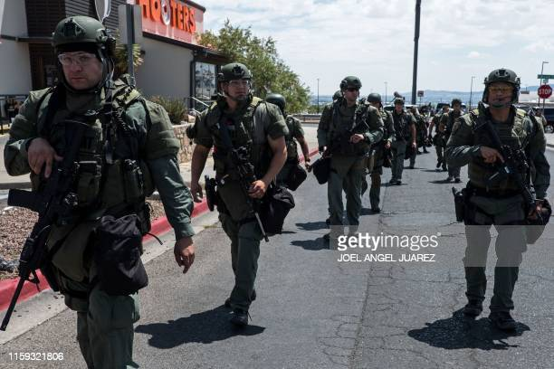 Law enforcement agents respond to an active shooter at a WalMart near Cielo Vista Mall in El Paso Texas on August 3 2019 A gunman armed with an...