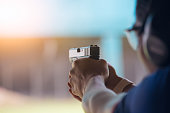 law enforcement aim pistol by two hand in academy shooting range