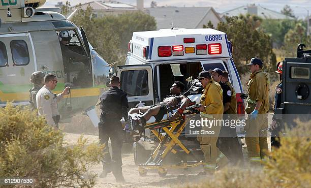 LANCASTER CALIF OCT 5 2016 Law enforcement and fire department personnel medevac a man suspected of shooting an LA County Sheriif's Department deputy...