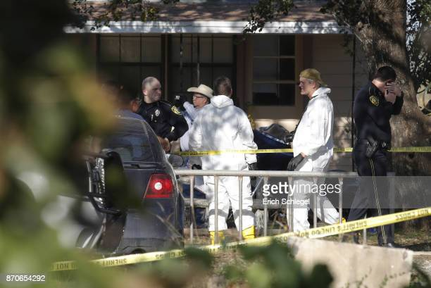 Law enforcement and forensic officials gather near the First Baptist Church following a shooting on November 5 2017 in Sutherland Springs Texas At...