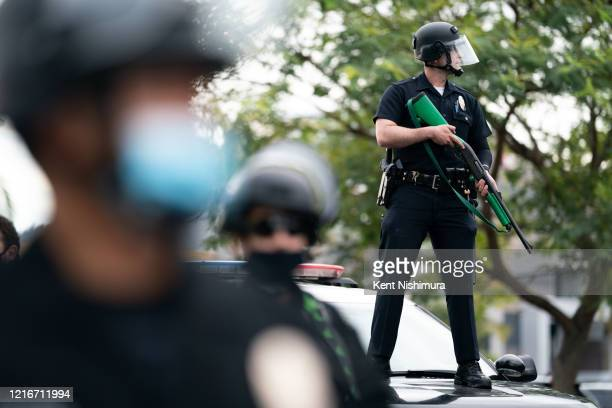 Law enforcement as protesters shout Hands up, dont shoot in the Fairfax District on Saturday, May 30, 2020 in Los Angeles, CA. Protests erupted...