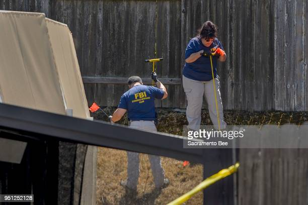Law enforcement authorities process evidence at the home of suspected East Area Rapist Joseph James DeAngelo in Citrus Heights Calif on Wednesday...