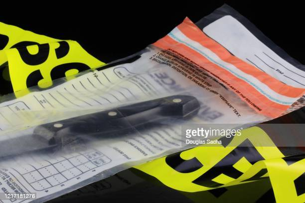 law enforcement bag for crime evidence with a knife - murder stock pictures, royalty-free photos & images
