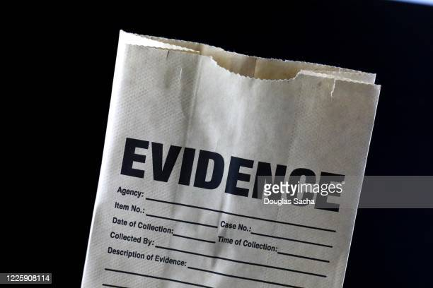 law enforcement bag used for items found at a crime scene - 証拠 ストックフォトと画像