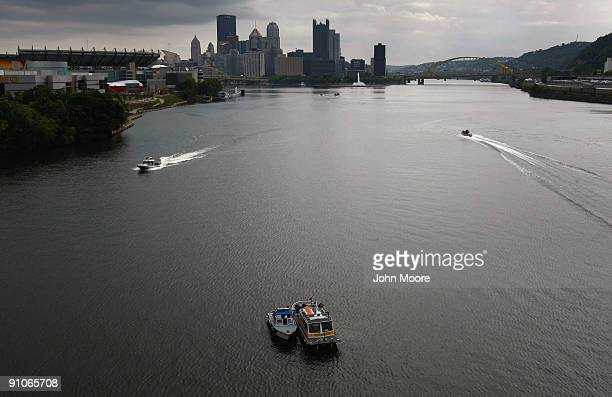 Law enforcement boats patrol the Ohio River ahead of the G20 summit on September 23 2009 in Pittsburgh Pennsylvania Large protests are expected...