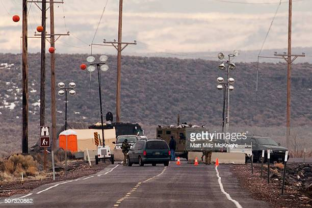 A law enforcement checkpoint blocks the road at the Malheur National Wildlife Refuge January 28 2016 near Burns Oregon On January 26 eight protestors...