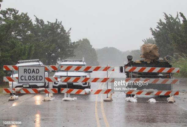 Law enforcement close the bridge to Pawleys Island during Hurricane Florence on September 14 2018 in Pawleys Island South Carolina Hurricane Florence...