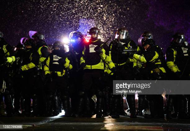 Law enforcement confronts protesters outside the Brooklyn Center police headquarters on April 13, 2021 in Brooklyn Center, Minnesota. Demonstrations...
