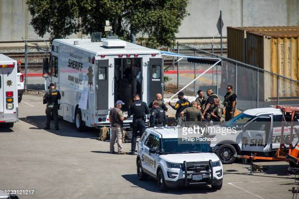 Law enforcement gather at the Valley Transportation Authority light-rail yard where a mass shooting occurred on May 26, 2021 in San Jose, California....
