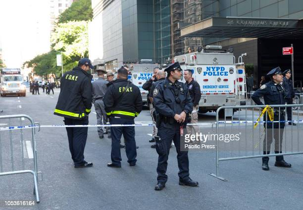 Law enforcement gather outside of the Time Warner Center after an explosive device was found there this morning
