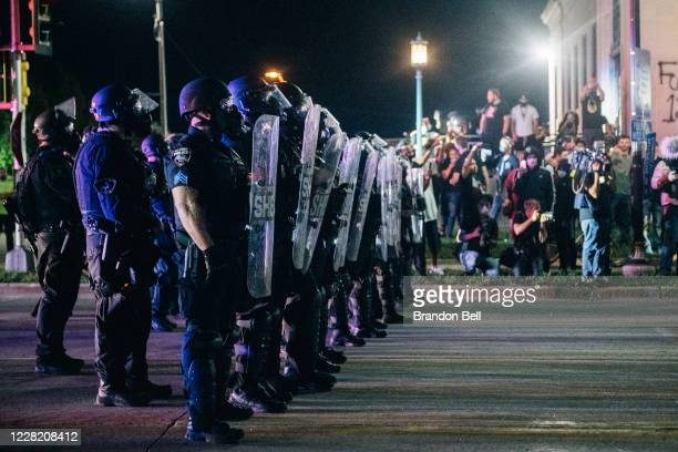 Law enforcement hold a line on August 25 2020 in Kenosha Wisconsin As the city declared a state of emergency curfew a third night of civil unrest...
