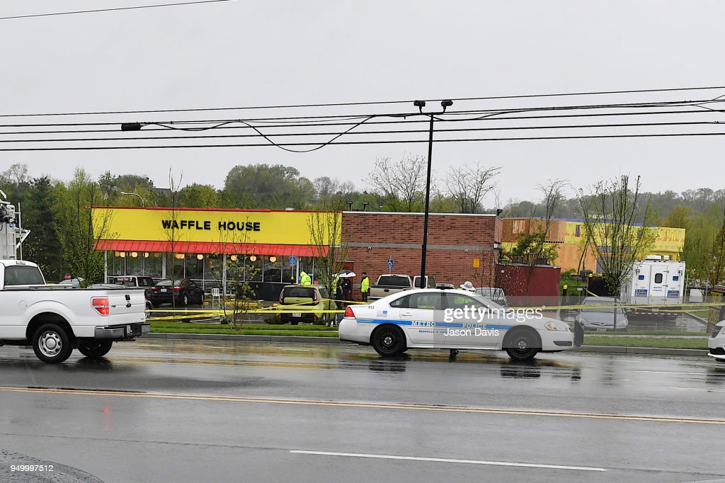 Law enforcement investigate the scene outside a Waffle House where four people were killed and two were wounded after a gunman opened fire with an assault weapon on April 22, 2018 in Nashville, Tennessee. Travis Reinking, 29, of Morton, IL, is person of interest in the shooting and is suspected to have left the scene naked.