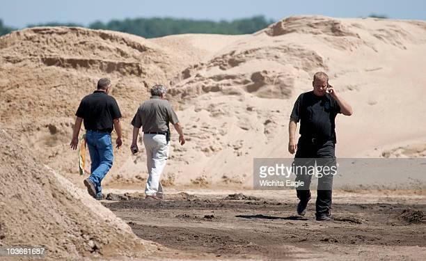 Law enforcement investigators work the scene at an asphalt plant southwest of Great Bend Kansas August 25 where a body was found Kansas Attorney...