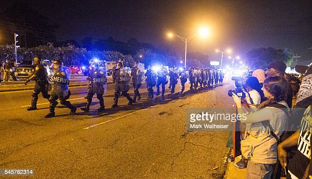 Law enforcement leave the protesters after moving in and making arrest on July 9 2016 in Baton Rouge Louisiana Alton Sterling was shot by a police...