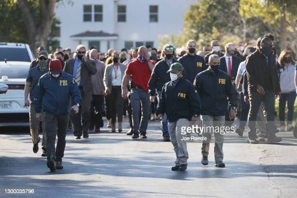 Law enforcement members leave the Broward County Office of Medical Examiner and Trauma Services after the killing of two FBI agents on February 02,...