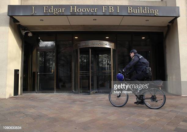 A law enforcement officer arrives at the J Edgar Hoover FBI Building on January 28 2019 in Washington DC Last Friday President Donald Trump signed a...