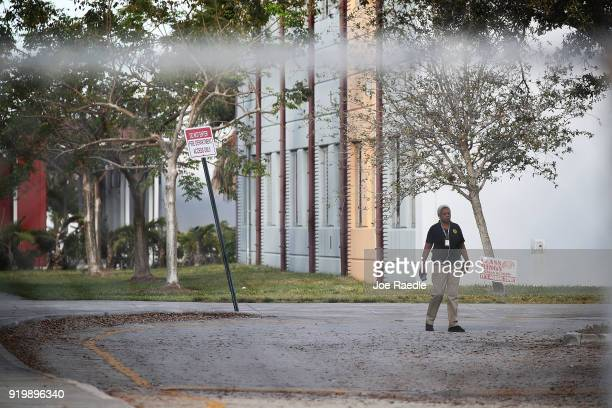 A law enforcement officer continues the investigation at Marjory Stoneman Douglas High School on February 18 2018 in Parkland Florida Police arrested...