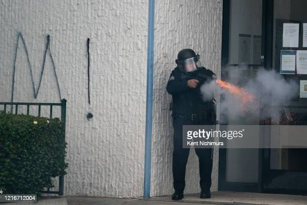 A law enforcement officer discharges his weeping at protestors in the Fairfax District on Saturday May 30 2020 in Los Angeles CA Protests erupted...