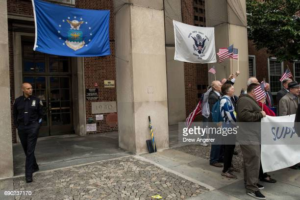 A law enforcement officer exits the building as supporters of Joe Concannon a retired NYPD captain and current candidate for NYC City Council...