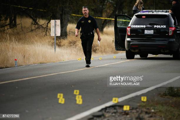 A law enforcement officer is seen at one of many crime scenes after a shooting on November 14 in Rancho Tehama California Four people were killed and...