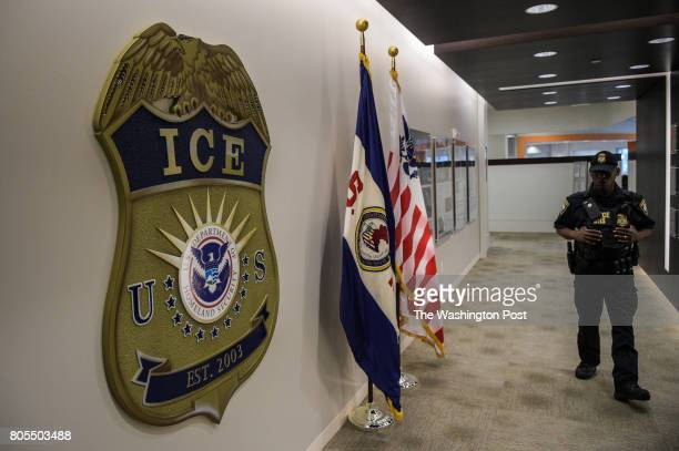 A law enforcement officer walks past ICE logo ahead of a press conference on Thursday May 11 at the US Immigration and Customs Enforcement...