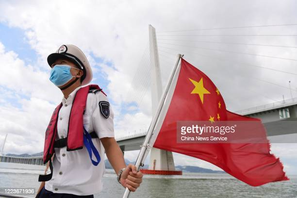 Law enforcement officer wearing face mask inspects at Shenzhen Bay on May 8, 2020 in Shenzhen, Guangdong Province of China.