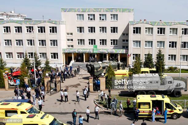 Law enforcement officers and ambulances are seen at the scene of a shooting at School No. 175 in Kazan, the capital of Russia's republic of...