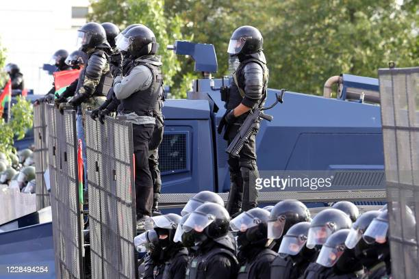 Law enforcement officers block a street during an opposition rally to protest against the presidential election results in Minsk on September 13 2020...