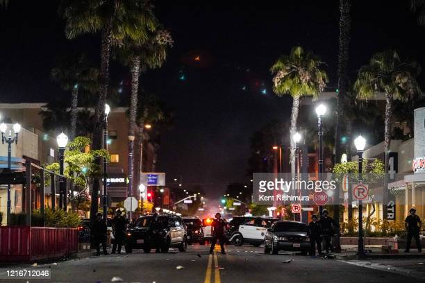 Law enforcement officers block Fourth Street at The Promenade North on Saturday May 30 2020 in Long Beach CA Protests have erupted across the country...