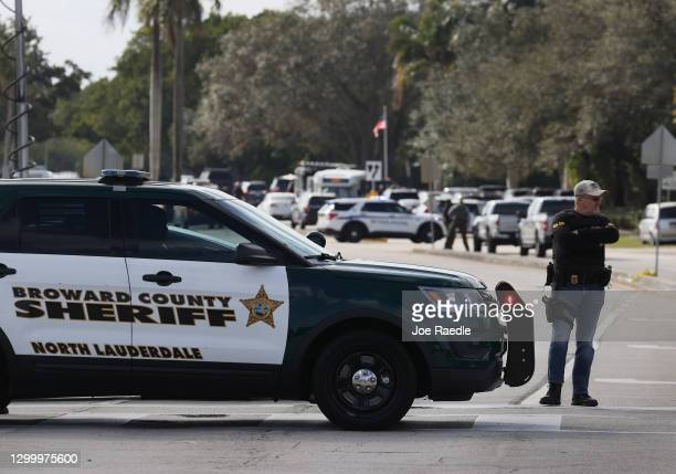 Law enforcement officers block off an area near where reports indicate that several FBI agents were shot as they served a warrant in a child...