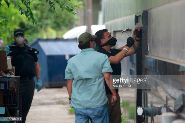 Law enforcement officers break down a backdoor at the Chinese consulate in Houston, Texas after the US State Department ordered China to close the...