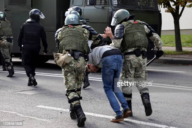 TOPSHOT Law enforcement officers detain a man during a rally to protest against the presidential election results in Minsk on September 13 2020...