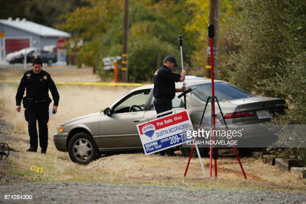 Law enforcement officers examine a vehicle that was involved in a shooting on November 14 in Rancho Tehama California Four people were killed and...