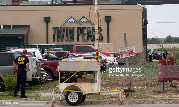 Law enforcement officers from around the area including the FBI and ATF are investigating the scene and providing security near Twin Peaks restaurant...