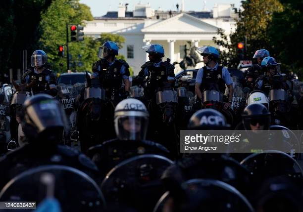 Law Enforcement officers hold a perimeter near the White House during protest on June 1 2020 in Washington DC Protests and riots continue in cities...