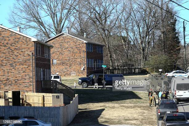 Law enforcement officers investigate the house belonging to Anthony Quinn Warner, a 63 year-old man who has been reported to be of interest in the...