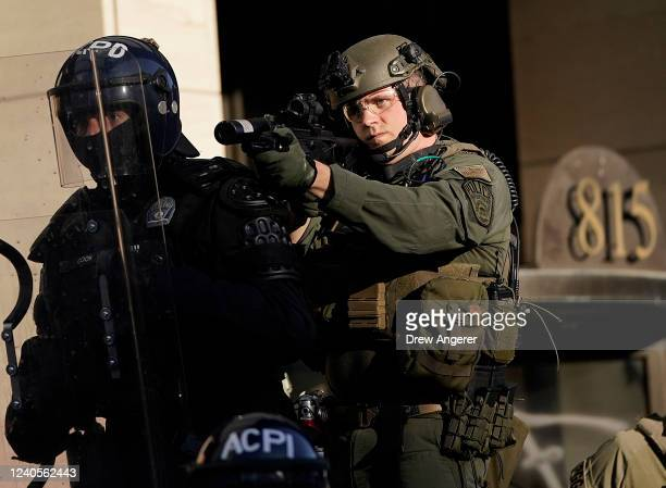 Law enforcement officers monitor a protest on June 1 2020 in downtown Washington DC Protests and riots continue in cities across America following...