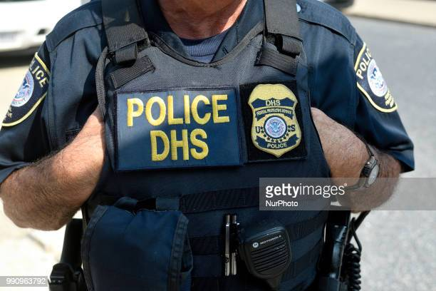 Law enforcement officers of the Philadelphia Police Department Homeland Security and National Park Service stands by as protestors build a small...