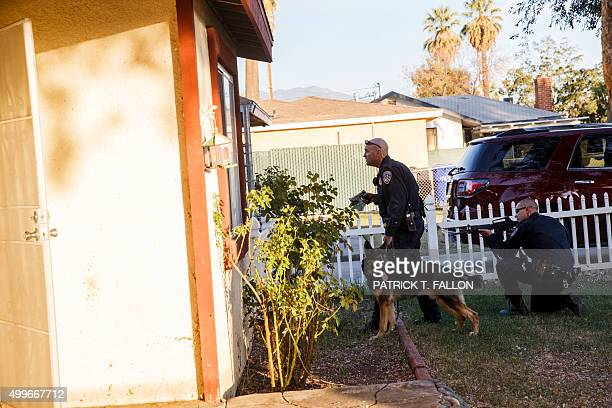 Law enforcement officers search for the suspects of a mass shooting December 2 2015 in San Bernardino California A man and a woman suspected of...